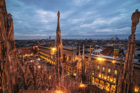 gothic: Milan, Italy: gothic roof of Cathedral in sunset Stock Photo