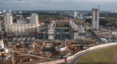 prefabricated buildings: Minsk, Belarus: construction of multi-stored houses in new part of city in the autumn