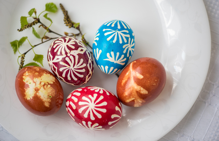 paschal: Homemade traditional decorated Eastern or Paschal eggs in white plate