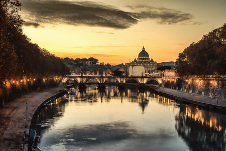 angelo: Rome, Italy: St. Peters Basilica, Saint Angelo Bridge and Tiber River in the sunset Stock Photo