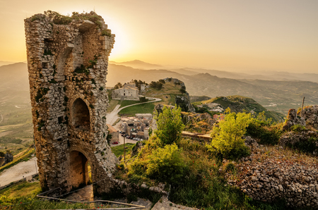 Aerial view of Mountain town Caltabellotta, Sicily, Italy in the beautiful sunset. Church of San Salvatore
