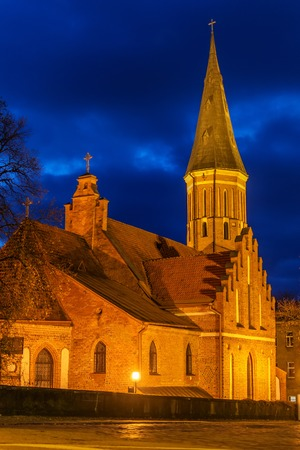 holy night: Kaunas, Lithuania: Vytautas the Great Church of the Assumption of The Holy Virgin Mary at night Stock Photo