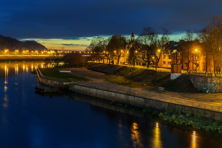 kaunas: Kaunas, Lithuania: Old Town next to Nemunas river at night Stock Photo