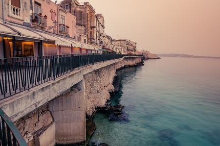ortigia: Sicily, Italy: Mediterranean coast of Syracuse in the sunrise