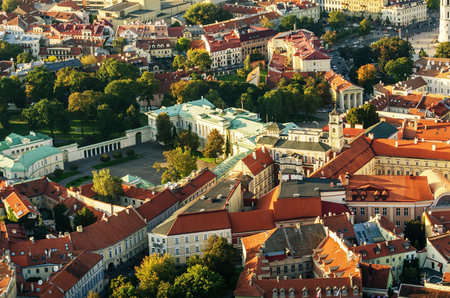 flying object: Center part of Vilnius, Lithuania in the sunset. Aerial view from piloted flying object.