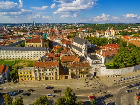 AERIAL. Old Town in Vilnius, Lithuania: the Gate of Dawn, Lithuanian: Ausros Vartai, Polish: Ostra Brama. Beautiful representative photography Stock Photo