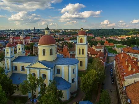 AERIAL. Old Town in Vilnius, Lithuania: Orthodox Church and monastery of the Holy Spirit, Lithuanian: Staciatikiu sv. Dvasios cerkve ir vienuolynas Stock Photo