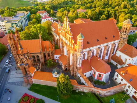 AERIAL TOP VIEW. Old Town in Vilnius, Lithuania: St Annes and Bernadines Churches, Lithuanian: Sv. Onos ir Bernardinu baznycios. Representative summer picture