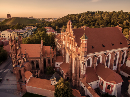 Aerial top view from UAV. Old Town in Vilnius, Lithuania: St Annes and Bernadines Churches, Lithuanian: Sv. Onos ir Bernardinu baznycios. Representative summer picture Stock Photo