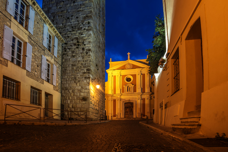 maritimes: Antibes, France: beautiful medieval city in French Riviera between Cannes and Nice at night. Church of the Immaculate Conception Stock Photo