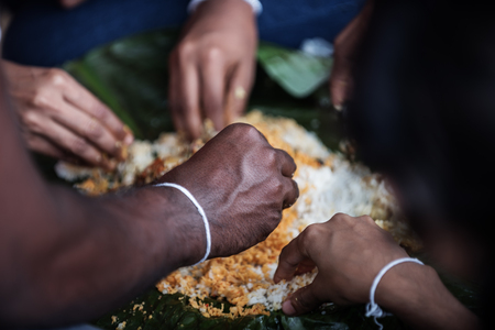 uneducated: Sri Lanka: family members eating traditional lunch with their hands