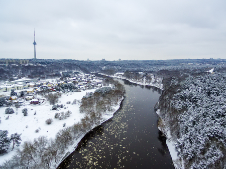 Vilnius, Lithuania: aerial top view of Neris river, Vingis park and TV tower in beautiful winter