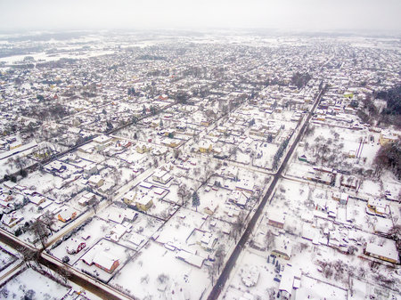 Aerial top view of snowy detached houses in winter Stock Photo