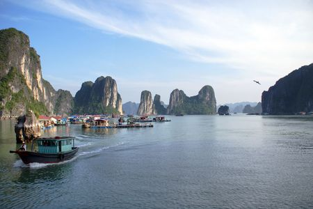 bays: Halong Bay: A beautiful sky and a beautiful junk boat amidst the beautiful islands.