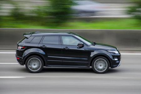 Land Rover Range Evoque on the highway.
