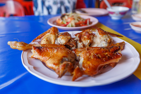 Papaya salad on table,National food of Thailand,Papaya salad and grilled Chicken select focus
