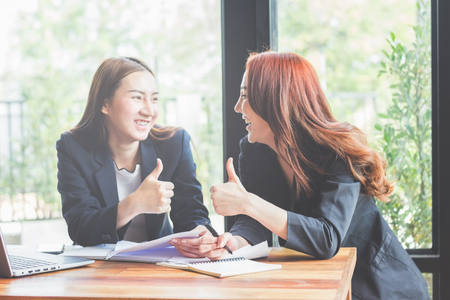 Business young woman agree to be partner,Sales manager are presenting export items to partner,Investors joint venture with customers,Secretary contacted the work successfully. Stock Photo