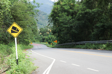 Road slope warning sign,Signs down mountain 写真素材