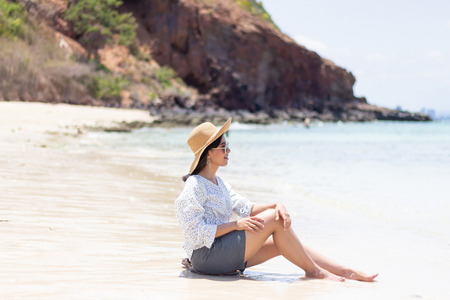 Young women traveling relax on the beach on summer, Concept beach on summer