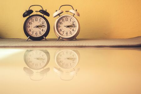 Close up alarm clock with reflection on ground, Vintage style