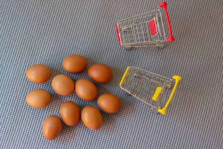 Cart and eggs with yellow background