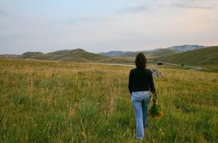 Woman on the mountain photo