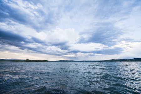 thunderstorm clouds above water Stock Photo - 12336677