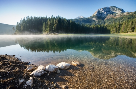 Beautiful Morning on a mountain lake  photo