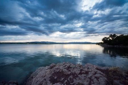 Dramatic sunset over quiet lake  Stock Photo - 17767016