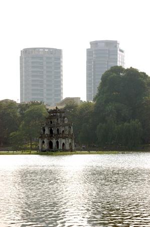 Hoan Kiem Lake with turtle pagoda on little island - centre of Hanoi, Vietnam. Stock Photo