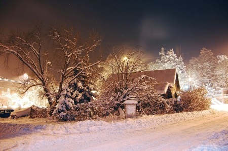Cottage covered by snow, freezing night photo