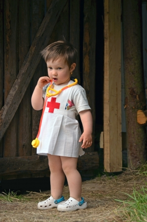 Portrait of a young girl in nurse costum photo