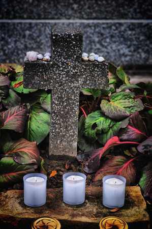all saints day: Candles burning at a cementary during All Saints Day. Stock Photo