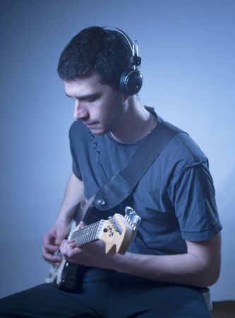 melodies: Young man playing guitar Stock Photo