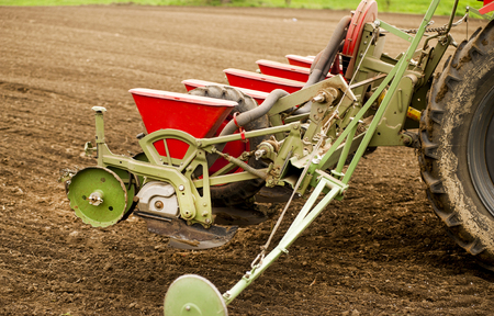 implements: Planting soybean on field