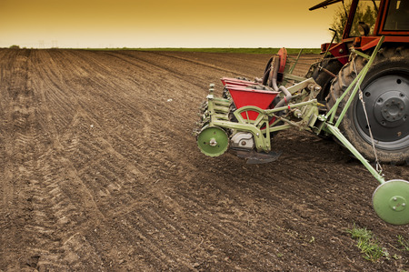 agricultural implements: Planting soybean on field