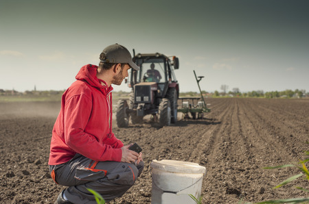 agricultural application tractor: Planting soybean on field