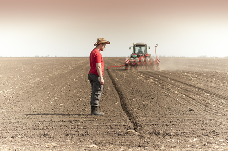 farm implements: Work on field during soy planting time
