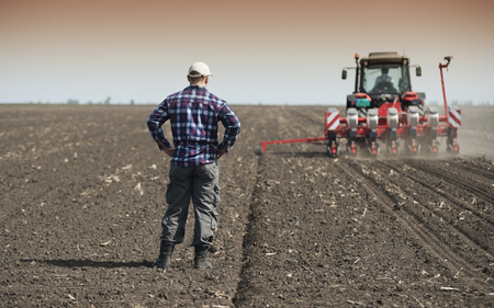 agricultural application tractor: Work on field during soy planting time