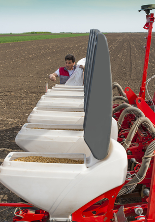 agricultural tenure: Work on field during soy planting time