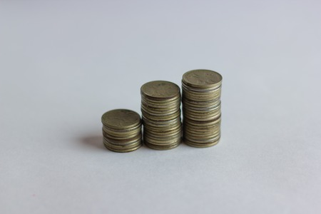 denominational: Side view of stacks of Russian coins increasing in height, on white studio background