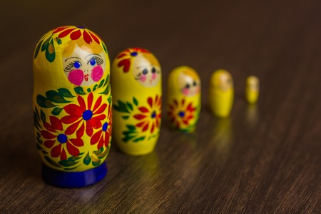 Russian nesting dolls,  babushkas or matryoshkas on wooden background Stock Photo