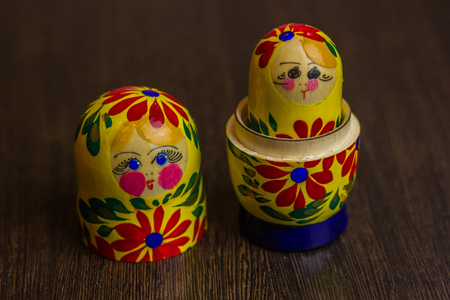 matroshka: Matryoshka, a Russian wooden doll on wooden table Stock Photo