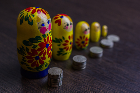 Russian coins and russian nesting doll matryoshkas or babushkas