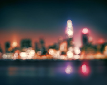 new york strip: Bokeh City lights abstract circular bokeh on blue twilight background Stock Photo