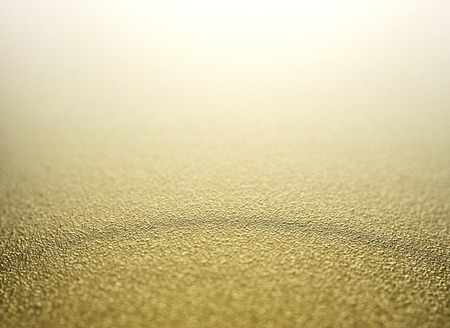 the copy: Gold defocused glitter background with copy space