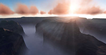 Morning in the canyon. Fog at the bottom of the canyon. Beautiful landscape at sunset.