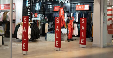 Showcases in large stores with the words of what sale
