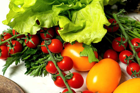 Cherry tomatoes and yellow tomato with lettuce with parsley Stok Fotoğraf