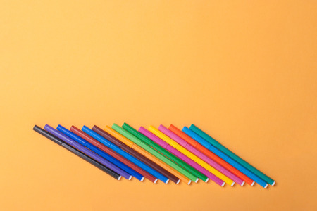 Multicolor Felt tip pens on yellow background. Stock Photo